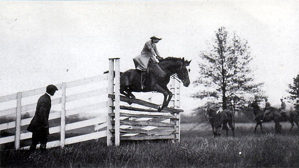 Mrs. Kenneth Schley is seen here jumping the gate in the early 1900s.
