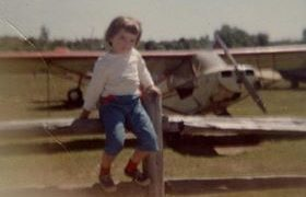 Local resident Deborah Lewis in 1959 sitting on the fence at the Somerset Hills Airport in Basking Ridge, New Jersey