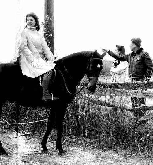 Jackie Kennedy taking a break from riding to chat with her husband John F. Kennedy, and her sister Lee Radziwill.