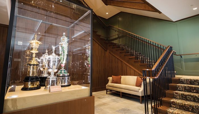 A cabinet featuring the trophies of the U.S. Open, U.S. Women's Open, U.S. Amateur, and U.S. Women's Amateur is displayed in the main lobby of the administrative building at the United States Golf Association campus in Liberty Corner.