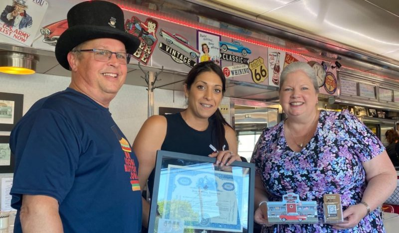 Mr-Local-History-presents an original stock certificate of the diner manufacturer to owner Maria Kallas and the Mayor of Keyport- Collette Kennedy